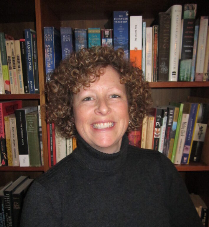 Nancy Payne Headshot in front of bookcase