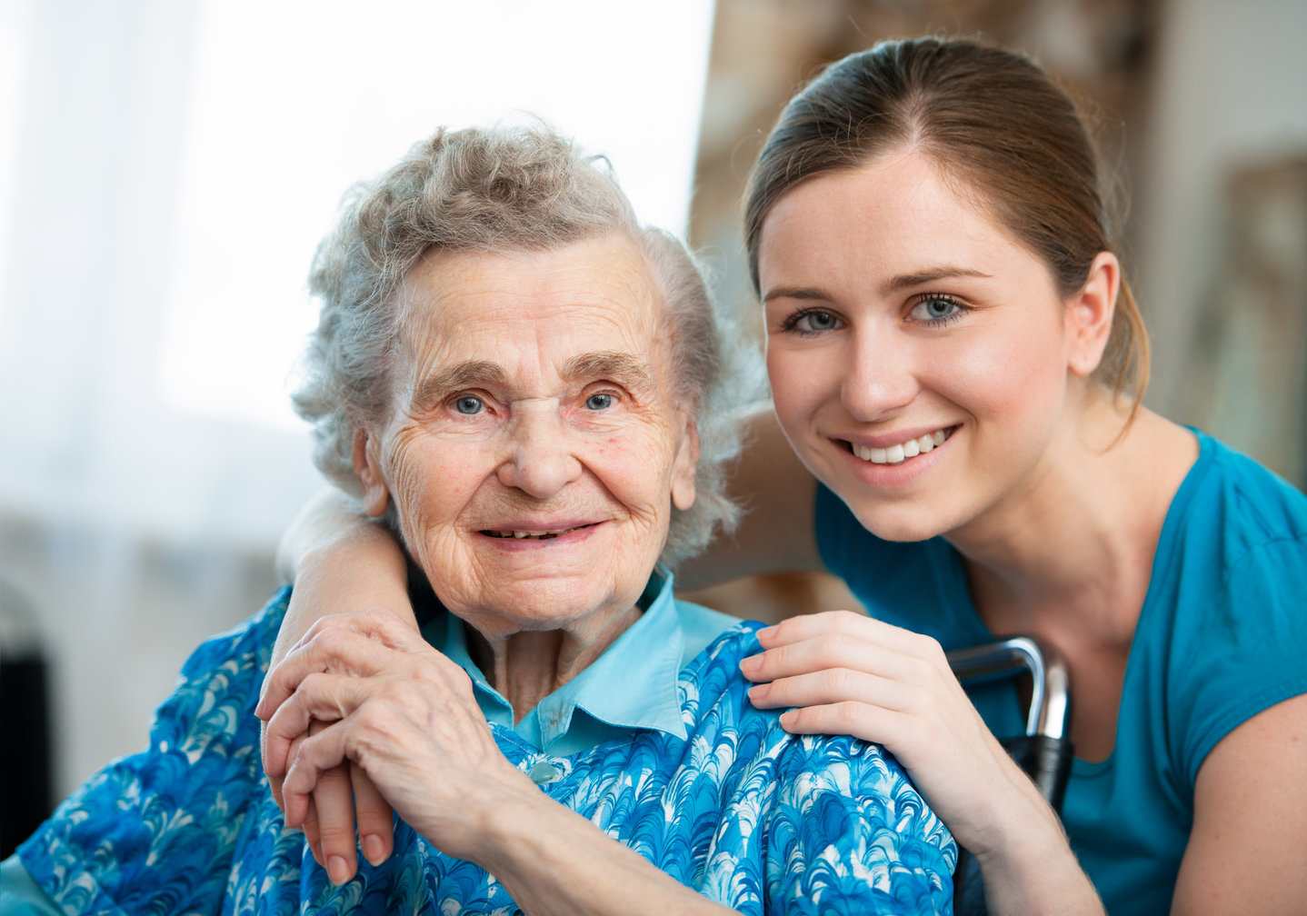 Senior and staff at a long-term care facility