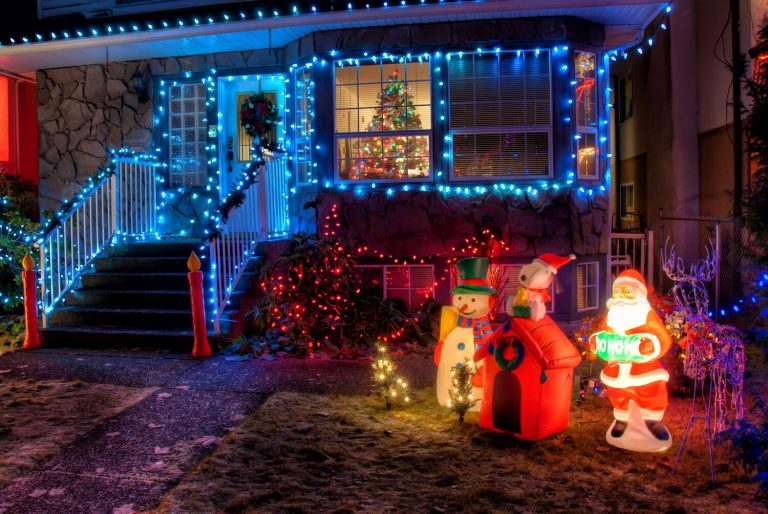 Exterior of a home covered in Christmas lights and decorations