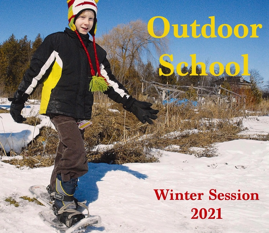 """Child on snow shoes smiles and walks towards a camera. On the left of him the poster reads """"Outdoor School"""" and """"Winter Session 2021"""""""