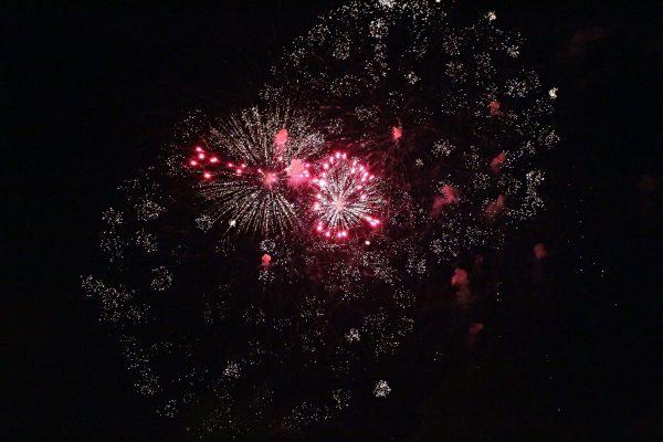 Red fireworks against a black sky