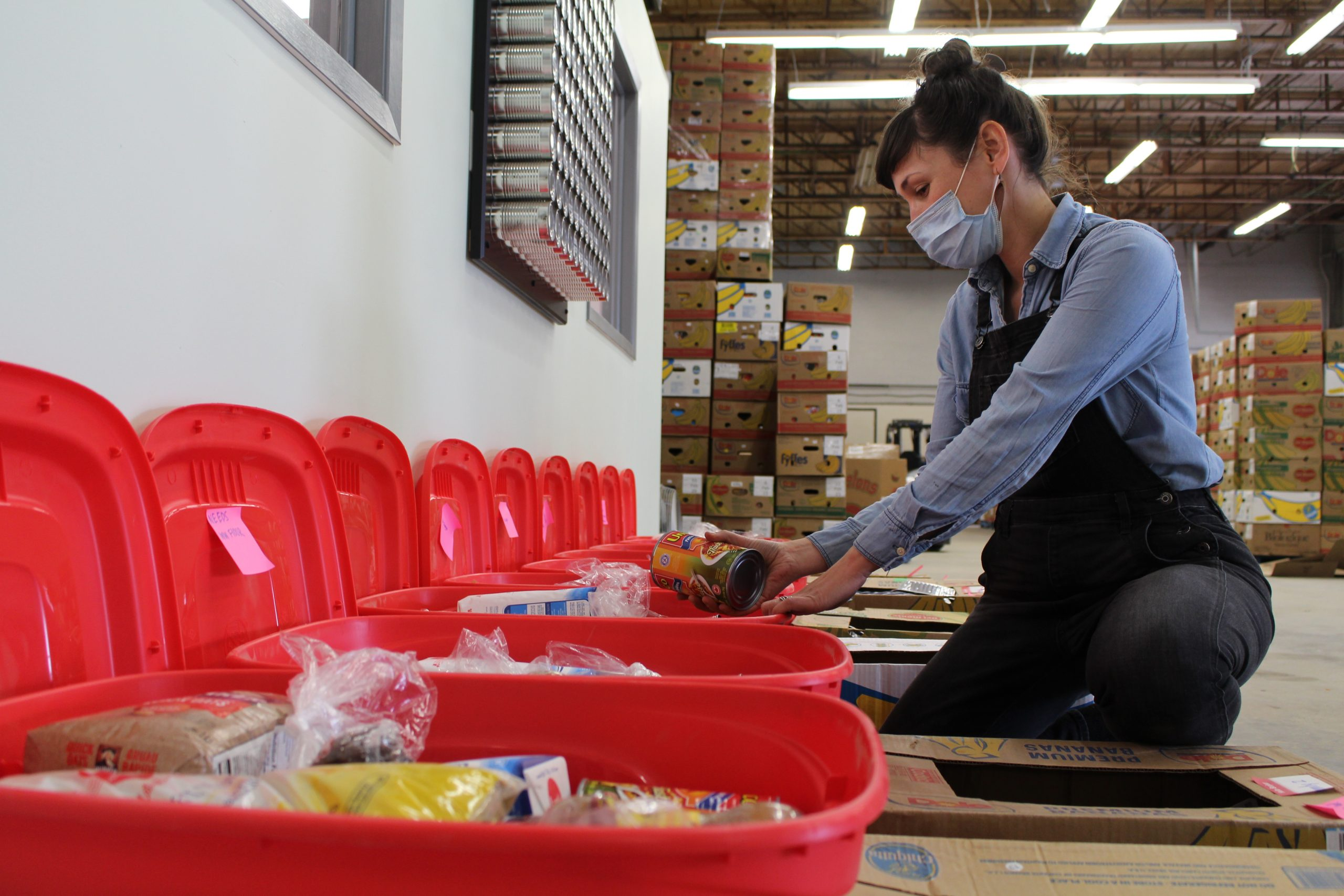 Amelia Boyd, Community Program Coordinator of KLFS packing the first round of meal kits for participants of the Family Cooking Project