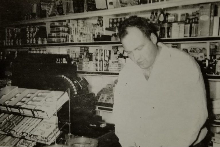 Ross Fisher Sr. at the counter of Fisher's Grocery Store in January of 1956. Photo courtesy of Wally Nugent.