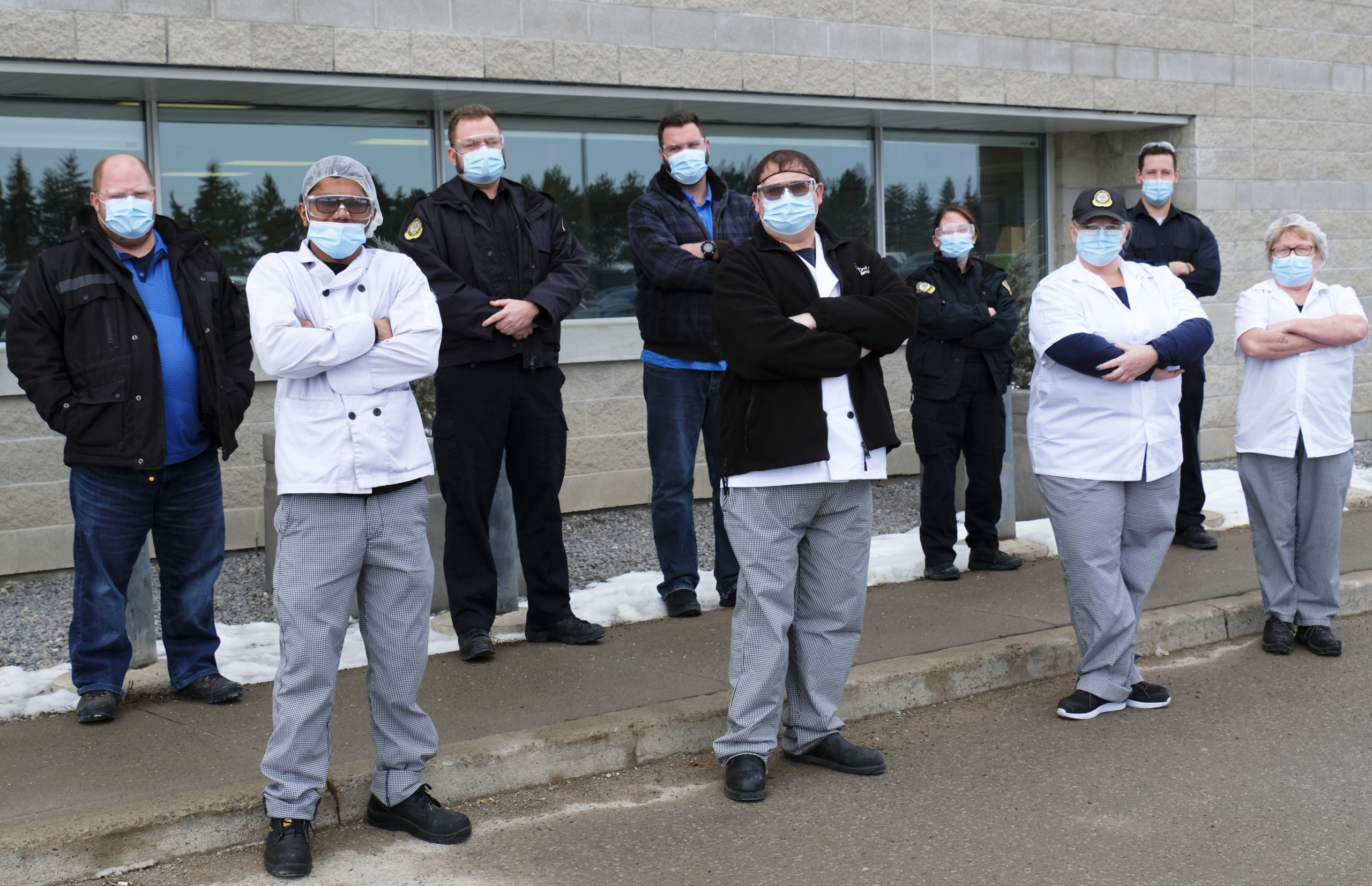 Nine union members standing outside of the Central East Correctional Facility in Lindsay ON